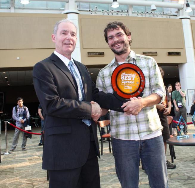 CEO of Coffee Fest David Heilbrunn with the 2nd Place Best Espresso winner in Seattle